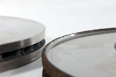 New and old disk brake rotors Stock Photography