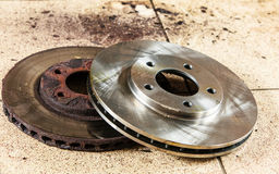 New and old front brake disks for modern car. Royalty Free Stock Images