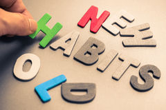 New and Old Habits. Hand arrange wood letters as Habits word with New and Old word context Stock Image