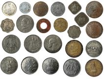 New and old indian coins in silver, copper, brass. Old, new and antique indian brass, copper, aluminium, silver, and other metal coins isolated on white with Stock Images