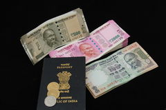 New and Old Indian Notes. New and Old Indian currency notes with Passport as concept of financial and international travel Stock Photo