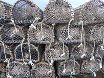 Old Lobster pots. Stacked up in a harbour Stock Photos