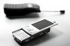 New and old mobile phones. How fast evolution in phones changes shapes an designs stock photos