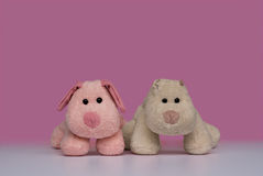 New and old puppy toys. New and old stuffed dog toys - conveys the concept of aging Stock Image
