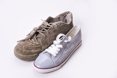 New and old sneaker side by side on white background Stock Image