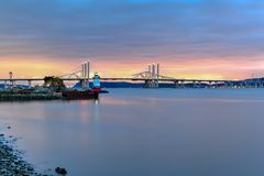 Tappan Zee Bridge - New York. New and Old Tappan Zee Bridges coexisting across Hudson River with a dramatic sunset royalty free stock photos
