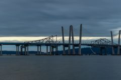 Tappan Zee Bridge - New York. New and Old Tappan Zee Bridges coexisting across Hudson River with a dramatic sunset royalty free stock photography