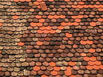 New and old tiles on the roof. New and old flat of red tiles placed on roof Royalty Free Stock Images