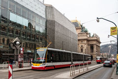 New and old tram at the National Theater in Prague Royalty Free Stock Photo