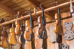 New and old violins in workshop. Musical instruments workshop with handmade violins Stock Photos
