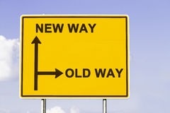 The new old way. Yellow traffic sign with arrows in two directions. One arrow shows the new way the other the old way, concept for making a change Stock Photos