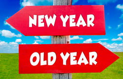 New and old year. S concept on the red signs with landscape in background stock illustration