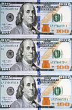 New one hundred dollar bill. Column of newly designed U.S. one hundred dollar bills (Benjamin franklin) . Money Concept Stock Photo