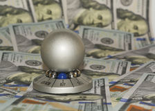 """New one hundred dollar bills and gift (souvenir) """"Ball for chosing the answer"""" with the choice """"sell"""" or """"buy"""" Royalty Free Stock Image"""