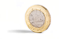 New One Pound Coin. A close-up shot of the new British one pound coin over a white background Royalty Free Stock Images