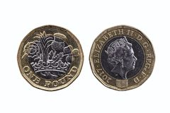 New one pound coin. Of England UK introduced in 2017 which show emblems of each of the nations cut out and isolated on a white background stock image