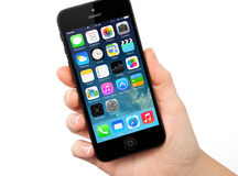 New operating system IOS 7 screen on iPhone 5 Apple Stock Photos