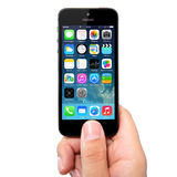 New operating system IOS 7 screen on iPhone 5 Apple Stock Photo
