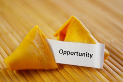 New opportunity. Closeup of a fortune cookie with opportunity message Stock Photos