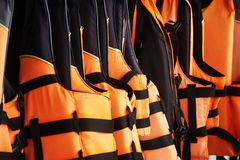 New orange black life jacket. New orange and black life jacket stock images