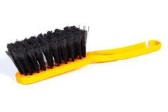 New orange broom for cleaning on white background Royalty Free Stock Photos