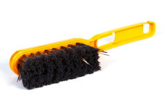 New orange broom for cleaning on white background Stock Images