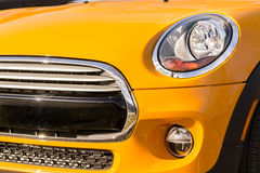 New orange car bumper and grille closeup royalty free stock images