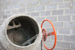The new orange cement mixer at a construction site. The new orange cement mixer at a construction site Stock Photo