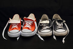 New orange and old blue sneakers. New orange sneakers and old blue sneakers Stock Photo