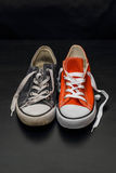 New orange and old blue sneakers Stock Image