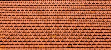 New Orange Roof Tiles. A white plaster house in Curacao with a red tile roof Stock Photo