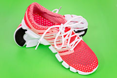 New orange and white running shoe, sneaker or trainer on green b Royalty Free Stock Photos