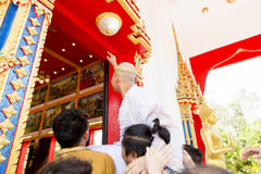 New ordained monk praying with a Thai Buddhist monk procession when male over 20 years old. New ordained monk praying with a Thai Buddhist monk royalty free stock images