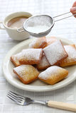 New orleans beignet, sprinkle powdered sugar with sieve Stock Images