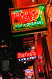 New Orleans Bourbon Street Drinks and Clubs. A bright, colorful nighttime shot looking down Bourbon Street looking at the Little Tropical Isle bar and Babe's Royalty Free Stock Photos