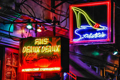 New Orleans Bourbon Street Strip Clubs and Bars. A brilliant colorful nighttime view of Fais Deaux Deaux, a bar, and the Stiletto's Gentlemen's club, one of many Royalty Free Stock Image