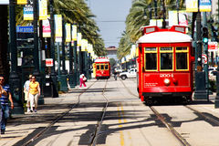 New Orleans Canal Line Street Car Tracks. Two of the many bright red and yellow easily accessible street cars running on Canal Street along the edge of the Royalty Free Stock Photography