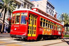 New Orleans Canal Street Street Car. One of the many bright red and yellow easily accessible street cars running on Canal Street along the edge of the French Royalty Free Stock Images