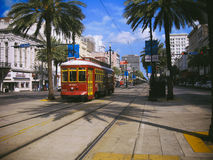 New Orleans Canal Street Streetcar. A streetcar among the palm trees lining Canal Street in New Orleans Stock Images