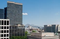 New Orleans city skyline and river bridge Stock Photos