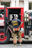 New Orleans Fireman suits up during an alarm Stock Image
