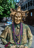 New Orleans French Quarter Street Performer in Mardi Gras Mask Stock Photo