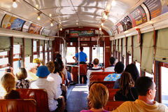 New Orleans Historic Street Car Passengers. Passengers fill the seats of one of the historic green St. Charles Avenue street cars in the Garden District running Royalty Free Stock Photography
