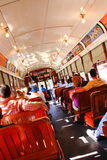 New Orleans Historic Street Car Riders. Passengers fill the seats of one of the historic green St. Charles Avenue street cars in the Garden District running Stock Photography