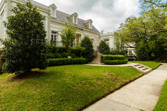 New Orleans Homes. New Orleans, LA USA - April 21, 2016: Beautiful homes in the upscale historic Saint Charles Avenue area Stock Photos