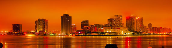 New Orleans just after sunset. Just after sunset - Skyline of New Orleans seen from the banks of the Mississippi river, Louisiana, USA Stock Photo