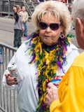 Mardi Gras onlooker. New Orleans, LA - February 9 2013 - An older woman gets ready for the Mardi Gras parade in New Orleans royalty free stock image