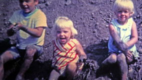 NEW ORLEANS, LA -1969: Kids playing in mud made from construction project.