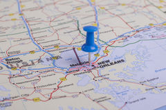 New Orleans, LA. Thumbtack placed over New Orleans, LA on a closeup of a map with thin depth of field royalty free stock image