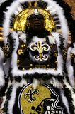 NEW ORLEANS,LA/USA -03-18-2012: An African American woman in Mar. Di Gras Indian New Orleans Saints costume. The Mardi Gras Indians are a long running tradition Royalty Free Stock Image